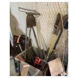 box of hand tools, rakes, post hole digger, rock r