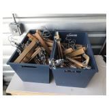 2 wooden boxes with lots of wooden hangers