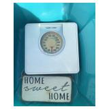 """Tote with scale, """"Home"""" sign and 3 colenders"""