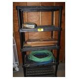 Black Shelving unit w/hose & contents