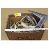 Box of shelf brackets, hangars
