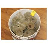 Bucket of Glass Insulators
