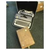 Electric Typewriter and a Pitney Bowes box with misc contents