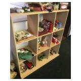 9 unit cubby shelf with assorted Christmas Items and decor