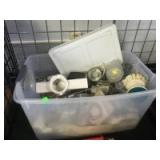 Plastic tote with assorted kitchen appliances and utensils