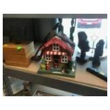 Various Carved Wood Statues, Christmas House, and more