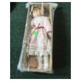 Porcelain faced doll