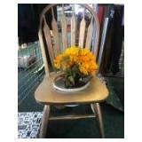 Repurposed chair into a flower pot holder