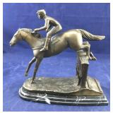 Bronze-Look Jockey on Horse Jumping Over Hurdle