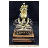 Brown and Gold Tone Buddha on Wooden Base