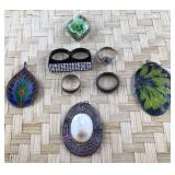 Small Lot of Four Rings and Four Pendants