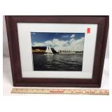 Framed Photograph of Sailboat next to Calvert
