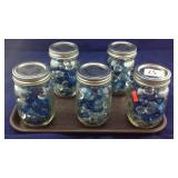 5 caning jars of glass beads