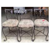 Three upholster metal bistro chairs