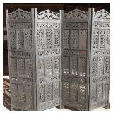 Ornately carved four panel room divider screen
