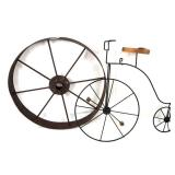 Decorative bicycle and old wagon wheel