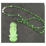 Green Beaded Necklace With Carved Figure Pendant