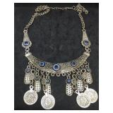 "Silver Tone Necklace With Blue ""Eyes"""