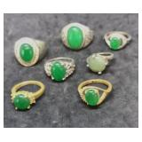 7 Silver and Gold Tone Rings With Green Center