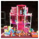 Large Barbie house and doll collection