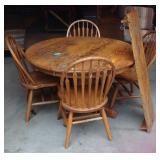 Contemporary round oak table and chairs