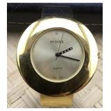 Lady's Large Gold Tone Bangle Watch