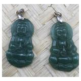 Pair of Translucent Green Stone Buddha Pendants.