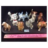 Nine vintage porcelain dog figurines
