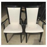 Two upholstered dining room chairs