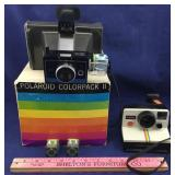 Two Polaroid Land Cameras