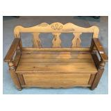 Knotty pine bench with storage area