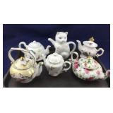 One Dozen Small Teapots