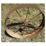 Tall antique wagon wheel