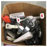 Box of Game Consoles and Controllers
