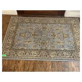 BLUE AND GOLD THEMED AREA RUG