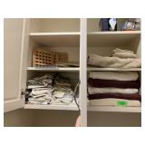 LOT OF TOWELS AND LINENS IN CABINET