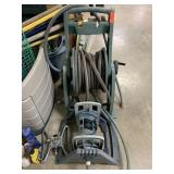 LOT OF WATER HOSES AND REEL