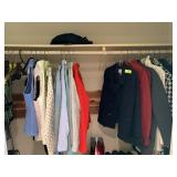 LOT OF CLOTHES IN CLOSET