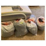 MULTIPLE BAGS OF CLOTHES