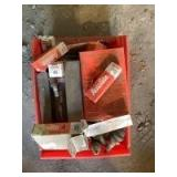 Box of New and Used Spark Plugs