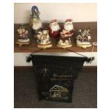 Santa figures and iron stocking holders