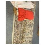Rug , wicker basket with table cloths, etc