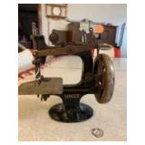 1920s Singer Sewing Machine. Toy or salesman sample. Also a vintage iron handle.