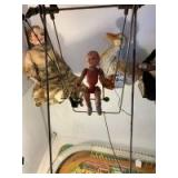 Vintage swing toy and cast iron figure