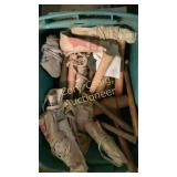 Tote of nail aprons and sledges and hammers