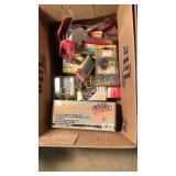 Box of staple guns and router bits
