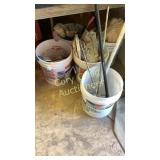 Several buckets of painting items