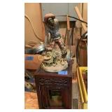 Cowboy statue and small stackable tables