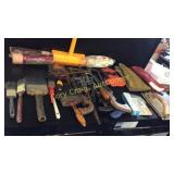Assorted paint brushes, Assorted hand saws, p