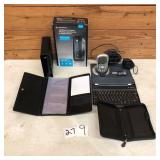 Modem, iPad Keyboard, Delphi XM Radio, organizers